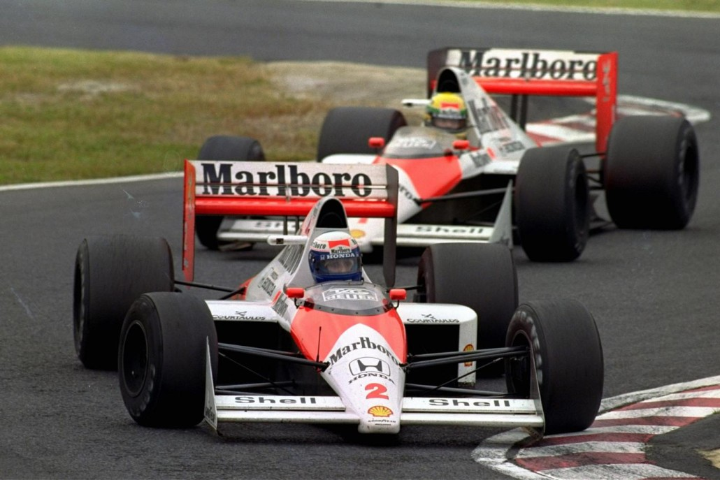 FILE - In this Oct. 22, 1989 file photo, French McLaren-Honda driver Alain Prost is chased by Brazilian teammate Ayrton Senna during the Japanese Formula One Grand Prix at Suzuka Circuit in Suzuka, central Japan. Japanese car manufacturer Honda is returning to Formula One in 2015 as an engine supplier to the automaker's former partner McLaren of Britain, Honda President Takanobu Ito announced the decision at a press conference in Tokyo on Thursday, May 16, 2013. (AP Photo/Tsugufumi Matsumoto, File)