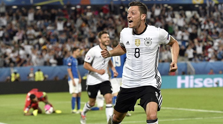 Germany's Mesut Ozil celebrates after scoring the opening goal during the Euro 2016 quarterfinal soccer match between Germany and Italy, at the Nouveau Stade in Bordeaux, France, Saturday, July 2, 2016. (AP Photo/Martin Meissner)