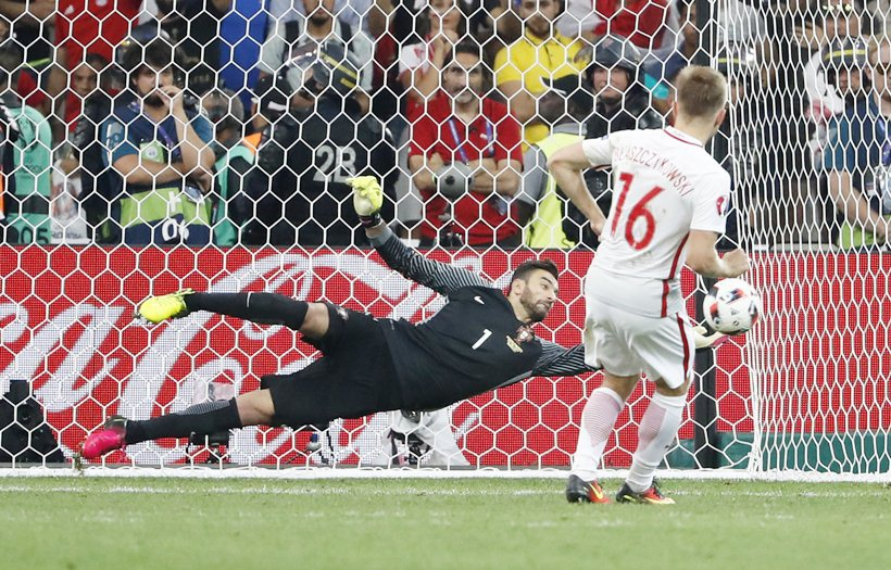 Poland v Portugal - EURO 2016 - Quarter Final - Stade Velodrome, Marseille, France - 30/6/16 Portugal's Rui Patricio saves from Poland's Jakub Blaszczykowski during the penalty shootout REUTERS/Yves Herman Livepic