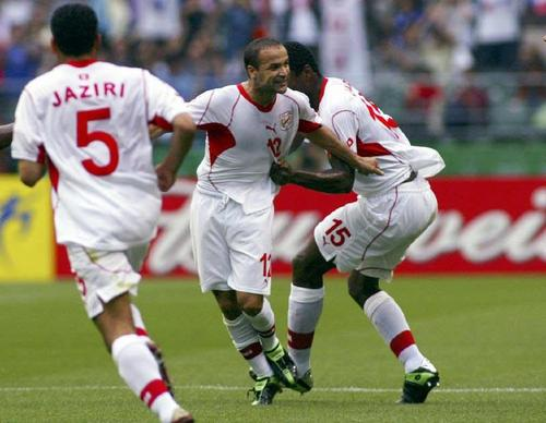 Football - 2002 FIFA World Cup Korea/Japan(tm) - Group H - Tunisia v Belgium - Oita Big Eye Stadium - Oita - Japan - 10/6/02 Raouf Bouzaiene celebrates after scoring the equalising goal for Tunisia from a free kick Mandatory Credit:Action Images / Alex Morton Digital