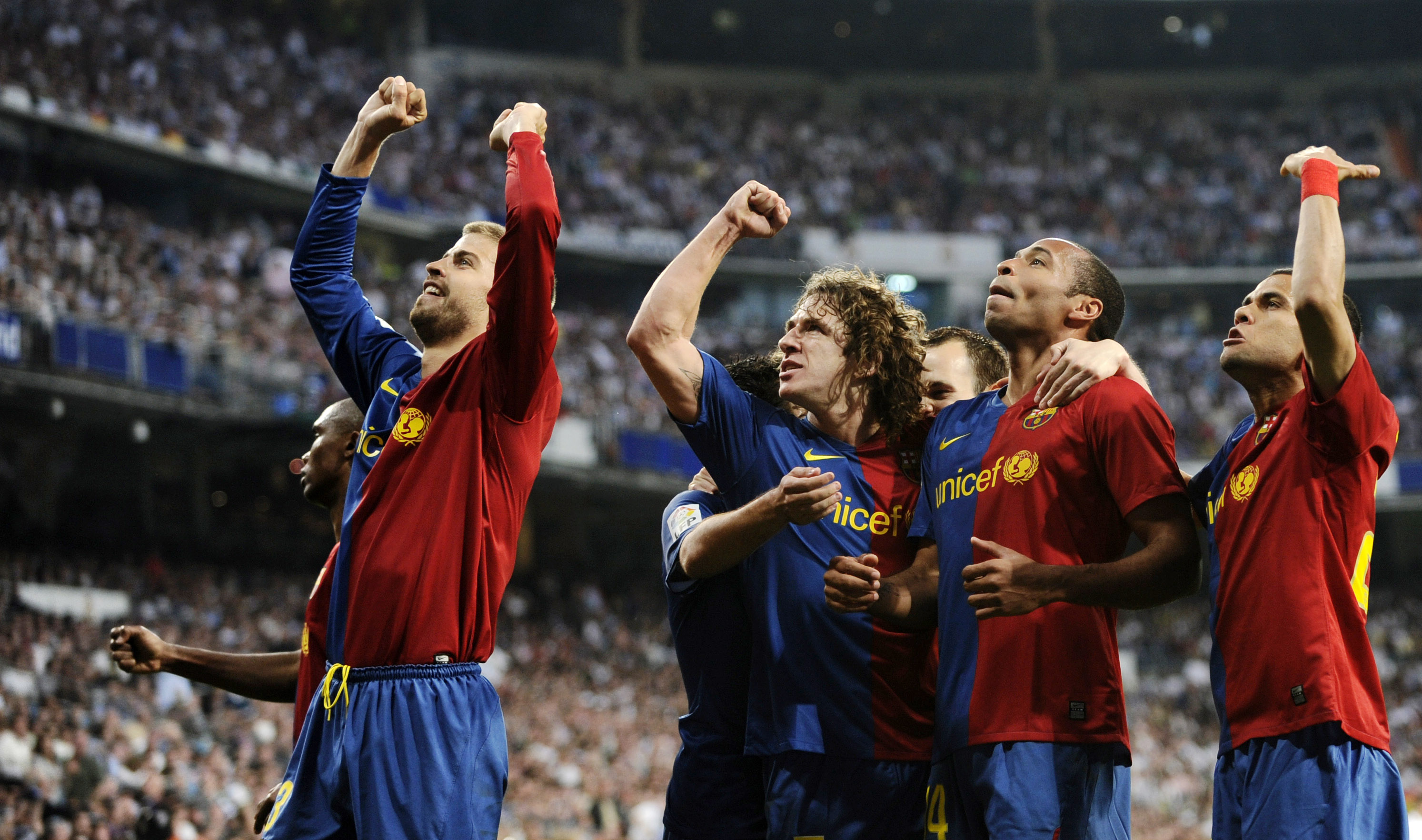 Barcelona's players celebrates their sixth goal against Real Madrid withduring their La Liga soccer match at the Santiago Bernabeu stadium in Madrid, Saturday, May 2, 2009. Barcelona won the match 6-2. (AP Photo/Daniel Ochoa de Olza)